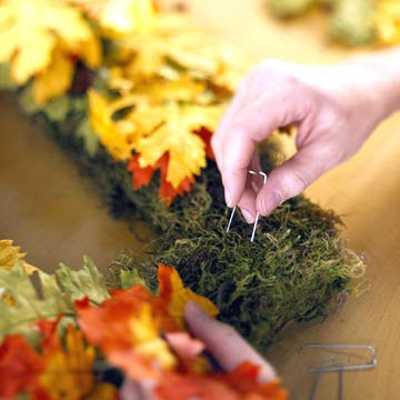 making wreath with fall leaves