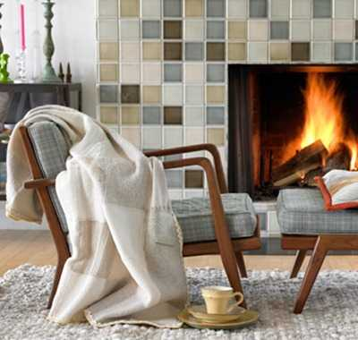 warm blanket on chair beside fireplace