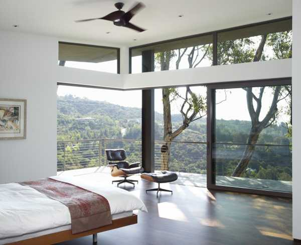 bedroom with glass door to terrace