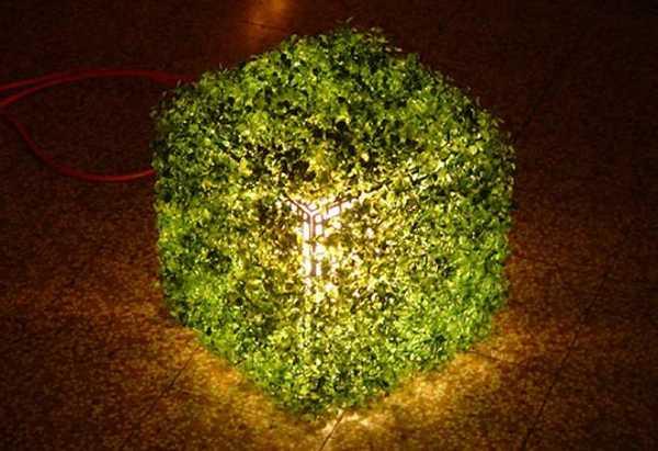 modern lighting fixture with green grass