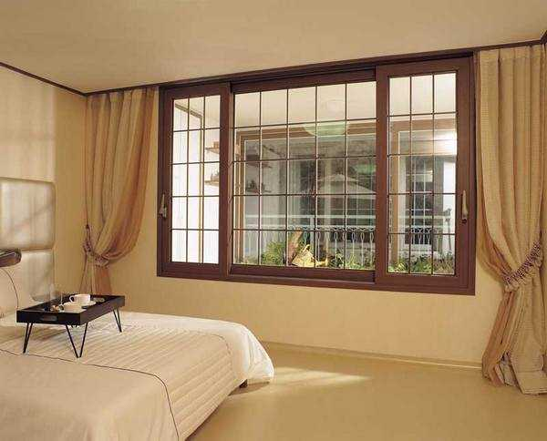 Eco friendly wood window designs vs contemporary plastic - Window design for home ...