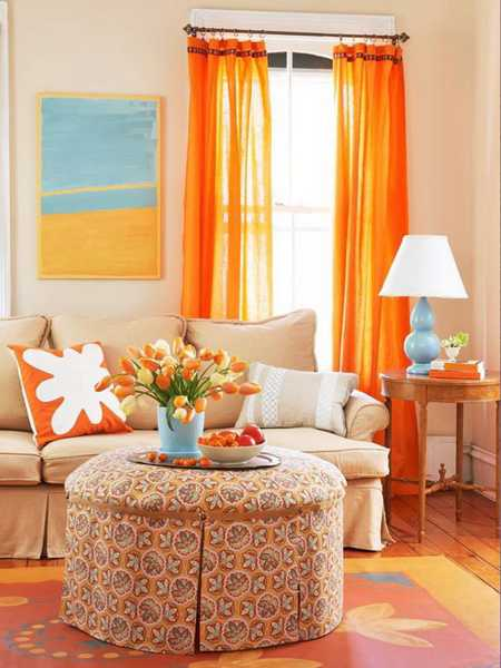 orange curtains and sofa cushions