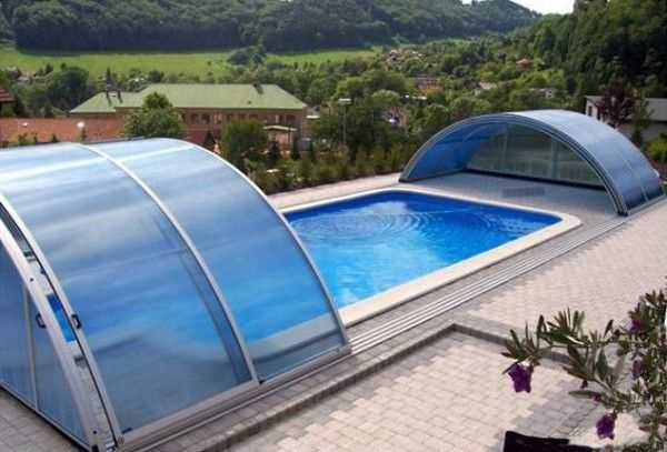 Telescopic Glass Enclosures With Sliding Segments Promising Enjoyable Swim Rain Or Shine