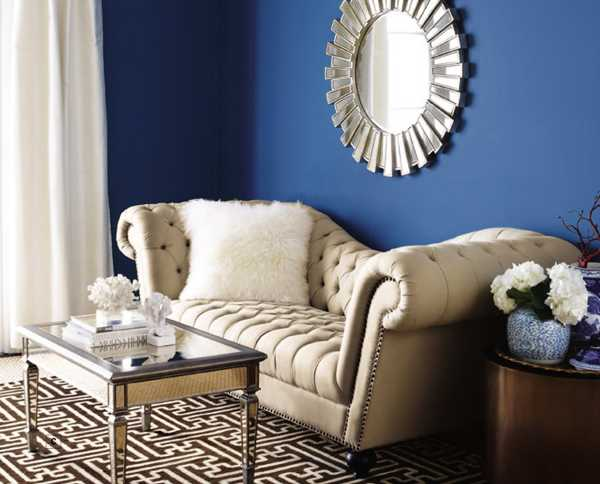 decorative mirror on blue wall