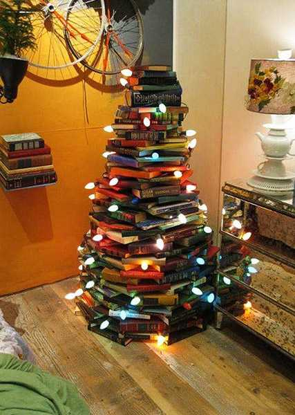 miniature christmas tree with star on the top alternative christmas tree design made of books - Miniature Christmas Tree Decorations