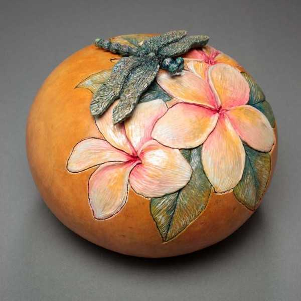 carved pumpkin with floral pattern
