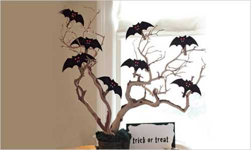black paper crafts, bats on tree branches