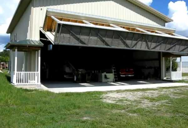 Hangar House Wall With Porch Turning Into Lifted Garage Door