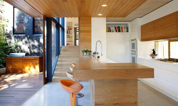 wood kitchen island and wooden ceiling design