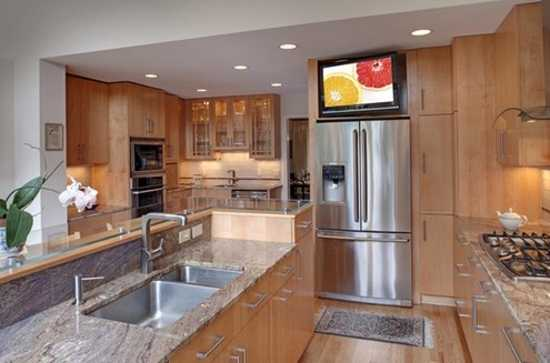Ordinaire TV Set On Stainless Steel Fridge, Light Wood Kitchen Cabinets And Large  Kitchen Island With Sink