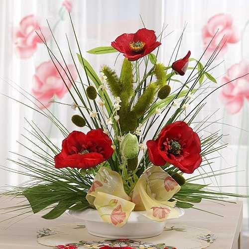 red poppy flower arrangement with green leaves