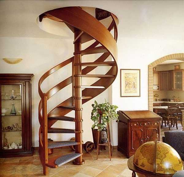 spiral stairs with curved wood railing