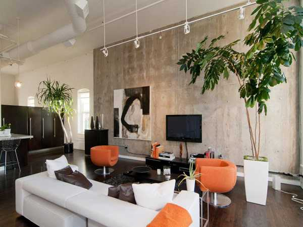 living room design with concrete wall and orange chairs