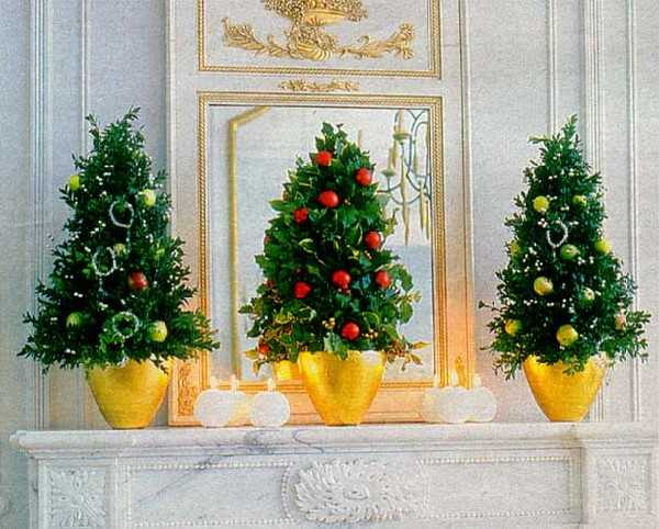 miniature christmas trees for fireplace mantel decorating
