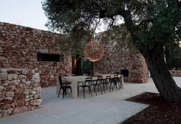 stone walls and patio furniture