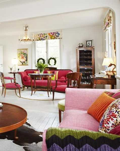 pink sofa with bright cushions