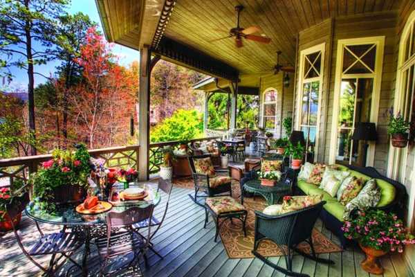 porch decorating with outdoor furniture and flowers