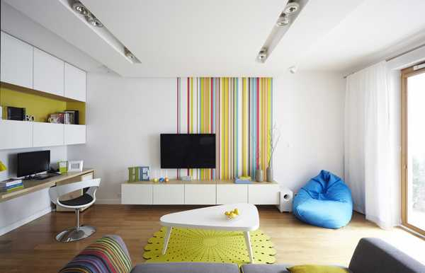 living room with colorful accent wall design
