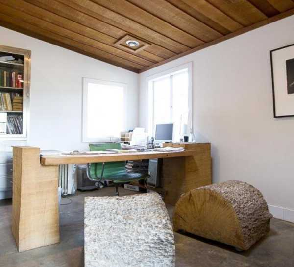 wood desk and seats made from tree trunk with bark