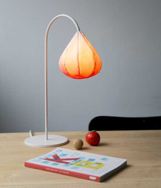 desk lamp with steel base and orange lamp shade