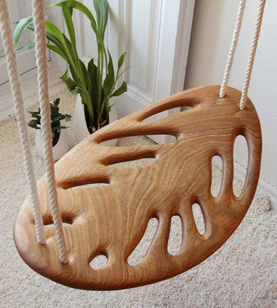 solid wood swing with ropes