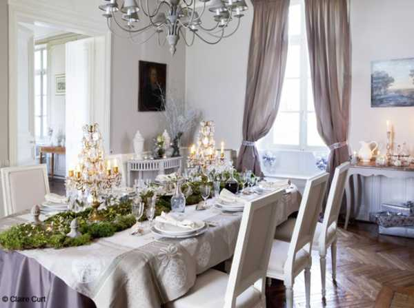 christmas table decoration green centerpiece linen tablecloth and window curtains in light gray color antique candelabras and candles - Elegant Christmas Decorating Ideas