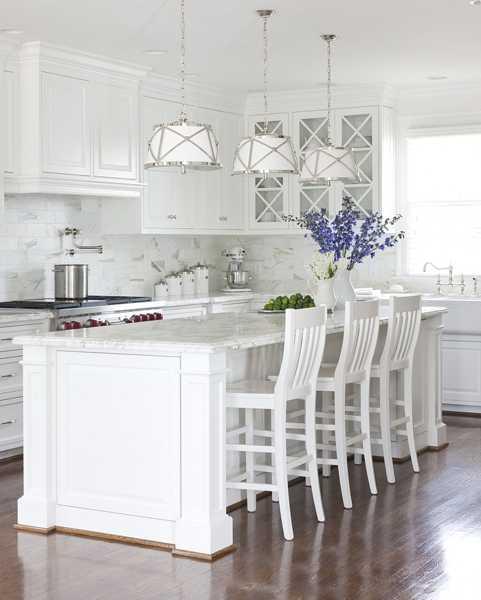 White Kitchen Cabinets, Marble Kitchen Countertops, Tile Backsplash Design,  White Pendant Lights Above White Kitchen Island Dining Area