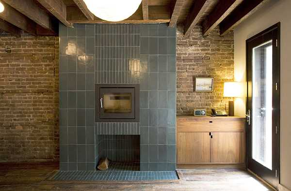 tiled fireplace design in dining room