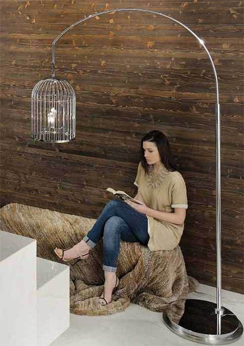 bird cage torchier in room with wooden wall paneling