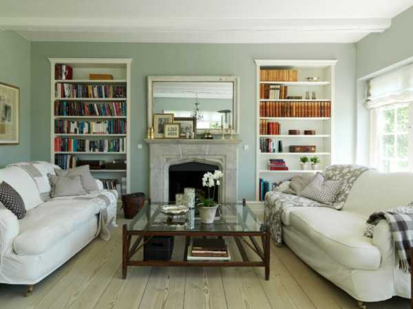 living room design with storage shelves and fireplace