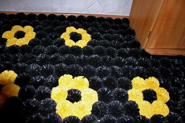 floor rug made of plastic bag pompoms