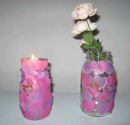 pink hearts vase with flowers and candle holder