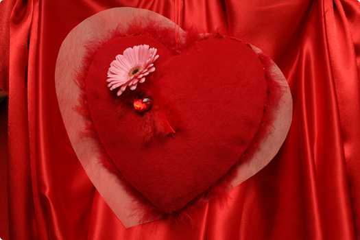red heart decoration with pink flower