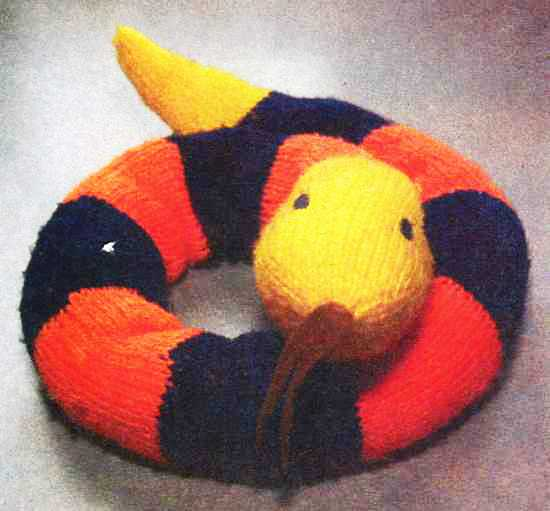 knitted snake in black and orange colors, soft kids toys and home decorations