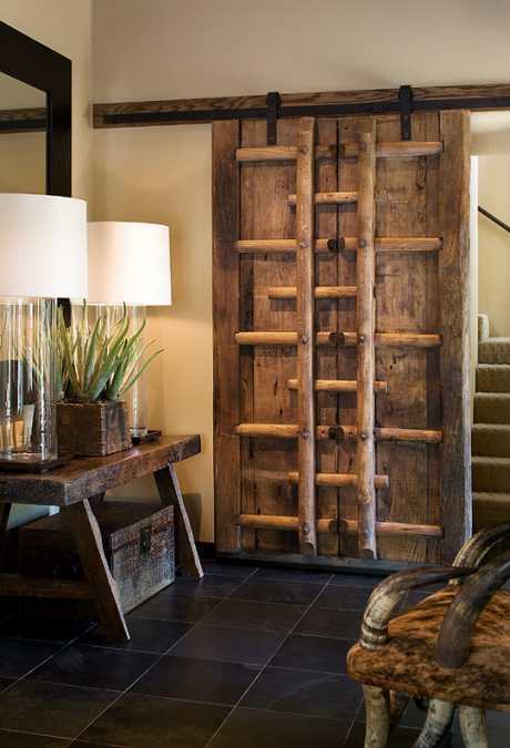 rustic wood entryway bench and wall design