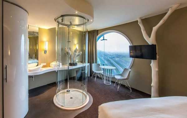 hotel room design with glass shower and large window