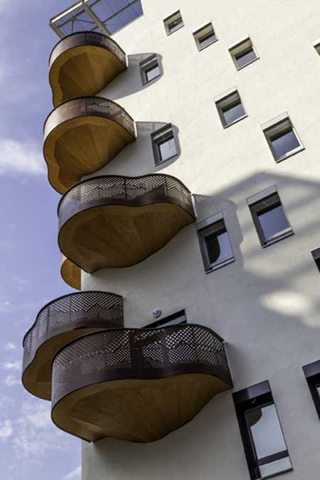 curvy balconies made of metal and wood