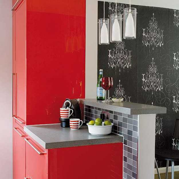 modern kitchen cabinets in red color and black wallpaper