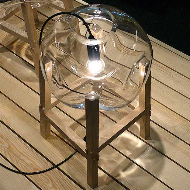 unique lighting fixture with wooden base
