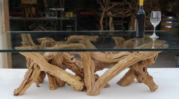 unique furniture, glass top table with base created of old grape vine