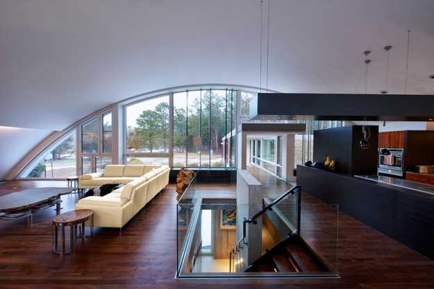 Modern House Design With Arc Roof Features Eco Friendly Contemporary Home Interiors