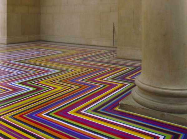 Modern Floor Decoration with Tape Strips Creating Cool Rainbow Design