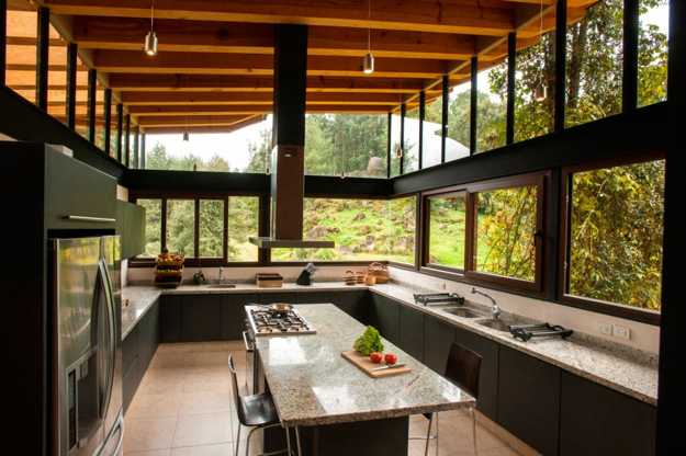Modern Kitchen Design With Large Windows And Wooden Ceiling Beams