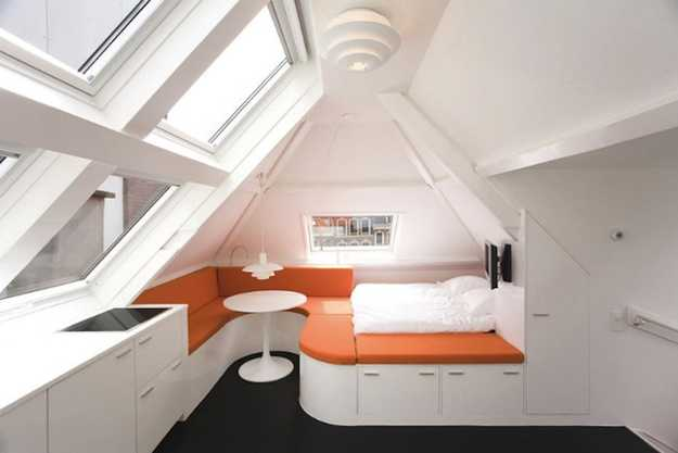 Smart Ideas For Decorating Small Apartments Featuring Antique Wood Built In Furniture And Bold Orange Accents