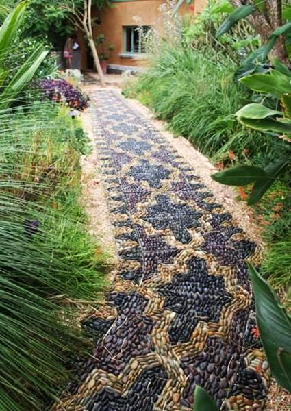 25 Unique Backyard Landscaping Ideas and Garden Path ... on Backyard Pebbles Design id=79786
