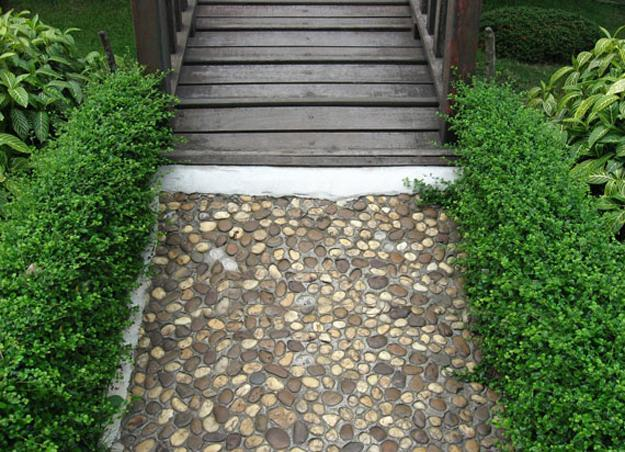 25 Unique Backyard Landscaping Ideas and Garden Path ... on Backyard Pebbles Design id=16274