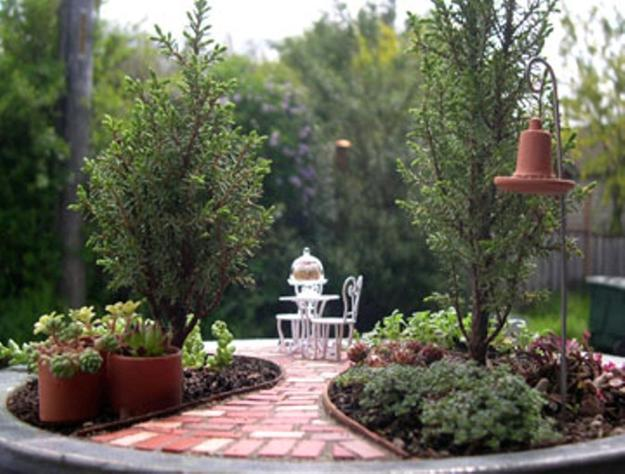 Amazing Miniature Garden Design With Patio Furniture And Lights