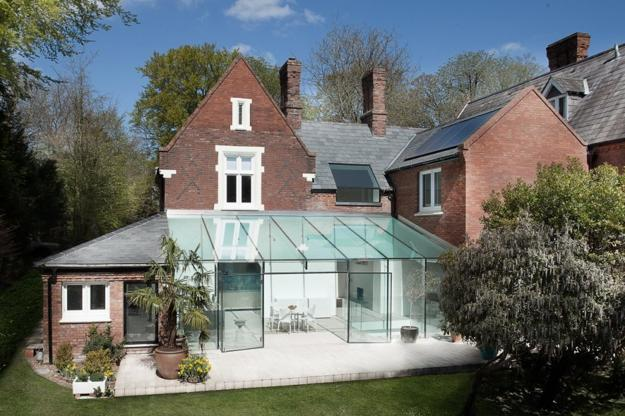 house design with glass extension, glass wall ceiling and glass doors