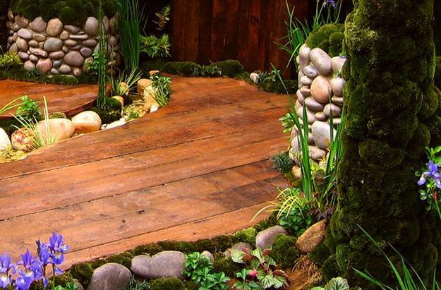 Wooden Deck Around A Small Pond And Water Garden
