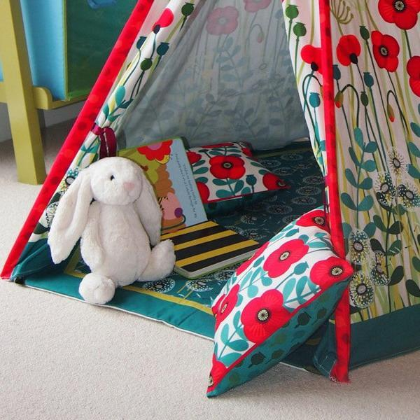tent and colorful cushions